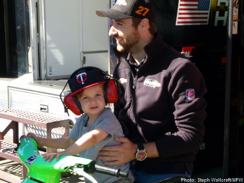 James Hinchcliffe entertains Alex Figge's son Tommy before Saturday morning practice at Sonoma Raceway.