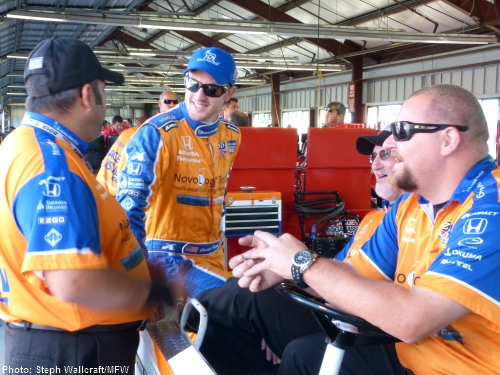 IndyCar's most recent race winner, Charlie Kimball, jokes around with his team before morning practice at Sonoma Raceway.