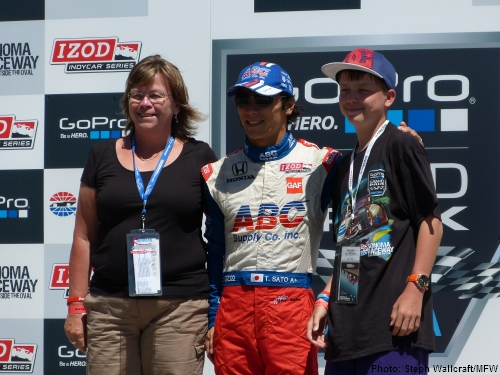 Takuma Sato poses for photos with fans on Saturday at the GoPro Grand Prix of Sonoma.