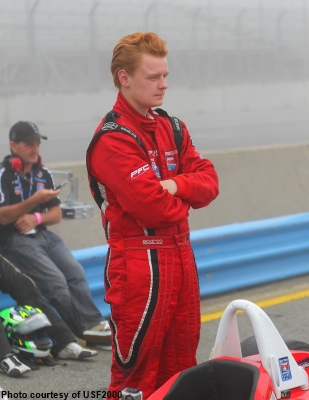USF2000 driver Daniel Burkett waits in the mist at Mazda Raceway