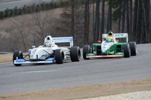 Overall winner Spencer Pigot chases race winner Scott Hargrove in the final round of Cooper Tires Winterfest at Barber Motorsport Park