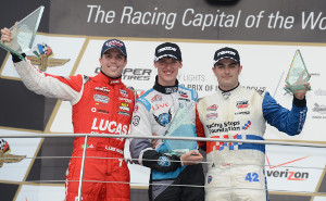 Matthew Brabham heads the Indy Lights podium in race 1 at the Grand Prix of Indianapolis