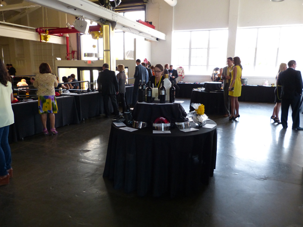 This photo does not do justice to the enormity of The Yellow Party's silent auction. It expanded far beyond this, and the items on offer were a motorsport collector's dream.